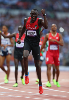 LONDON, ENGLAND - AUGUST 09:  David Lekuta Rudisha of Kenya celebrates after winning gold and setting a new world record of 1.40.91 in the Men's 800m Final on Day 13 of the London 2012 Olympic Games at Olympic Stadium on August 9, 2012 in London, England.  (Photo by Michael Steele/Getty Images)